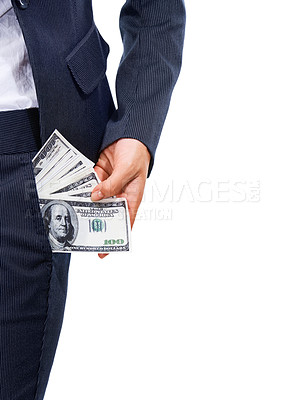 Buy stock photo Cropped image of a businesswoman pulling cash out of her pocket