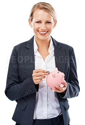 Buy stock photo A gorgeous businesswoman putting a coin into her piggy bank
