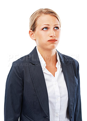 Buy stock photo A young businesswoman looking bored and frustrated