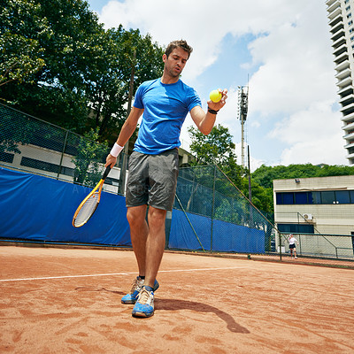 Buy stock photo Shot of a tennis player getting ready to serve