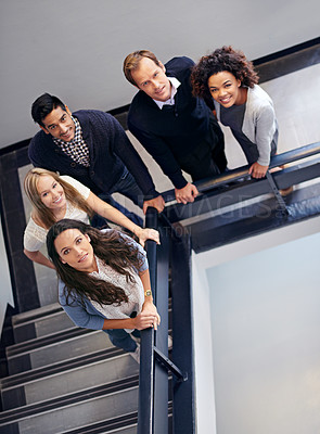 Buy stock photo Portrait of a group of office coworkers standing in a stairwell