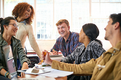 Buy stock photo Shot of students hanging out together between class