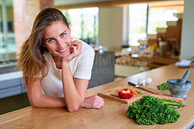 Buy stock photo Portrait of an attractive young woman leaning on her kitchen counter