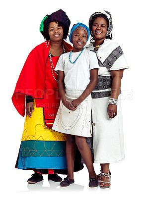 Buy stock photo Studio shot of two traditiaonally dressed african women with a teenage girl isolated on white