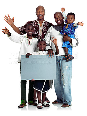 Buy stock photo Studio shot of two african men with their kids holding a blank board, isolated on white