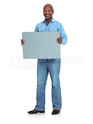 Buy stock photo Studio shot of an african man holding up a blank board against a white background