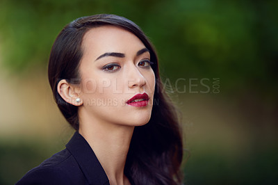 Buy stock photo Outdoor portrait of an elegant young woman in a feminine suit