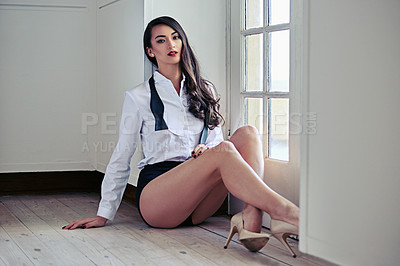 Buy stock photo Portrait of an beautiful young woman in a dress shirt and underwear sitting on a floor