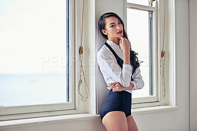 Buy stock photo Shot of an attractive young woman posing in a sexy ensemble