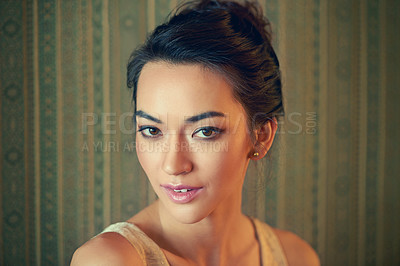 Buy stock photo Portrait of a beautiful and elegant young woman in a green wallpapered room