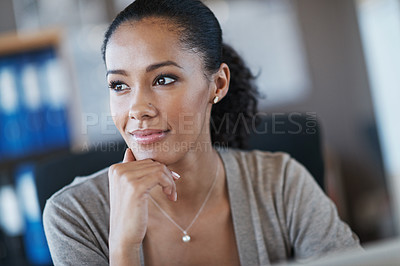 Buy stock photo A young businesswoman looking away while smiling