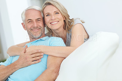 Buy stock photo Portrait of a happy mature couple relaxing at home