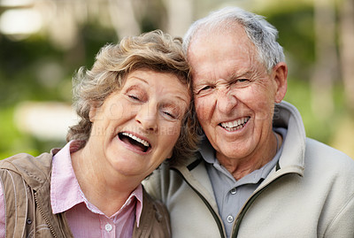Buy stock photo Portrait of a loving mature couple laughing together in park