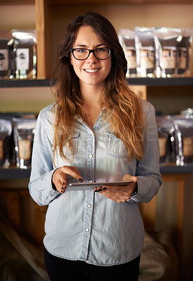Buy stock photo Portrait of a beautiful woman standing proudly in her store with a digital tablet