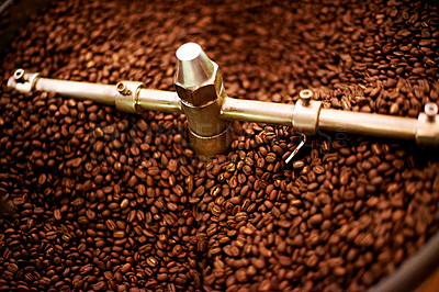 Buy stock photo Closeup of roasting coffee beans being turned