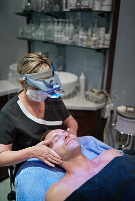Buy stock photo Shot of a man getting a facial treatment at a beauty clinic