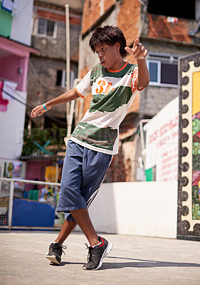 Buy stock photo Shot of a young male breakdancer in an urban setting