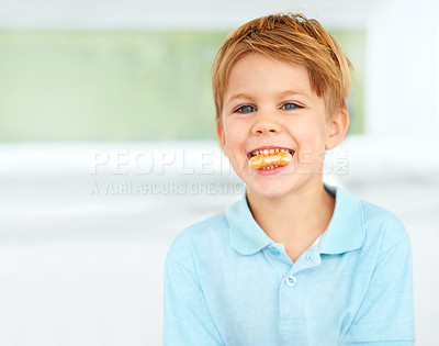 Buy stock photo Shot of a little boy eating a orange