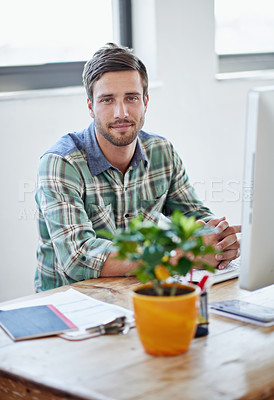Buy stock photo Portrait of a young designer working on a computer in an office