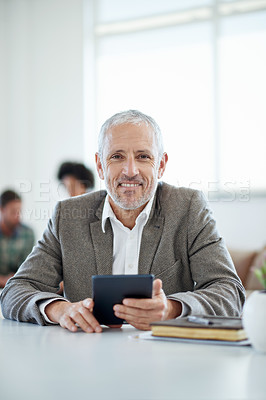 Buy stock photo Portrait of a mature businessman sitting at a table in an office