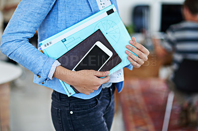 Buy stock photo Cropped shot of a woman carrying paperwork while standing in an office