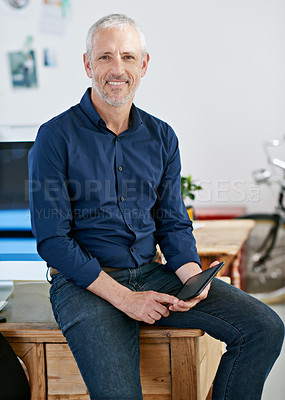 Buy stock photo Portrait of a mature businessman holding a digital tablet. The commercial designs displayed in this image represent a simulation of a real product and have been changed or altered enough by our team of retouching and design specialists so that they are free of any copyright infringements