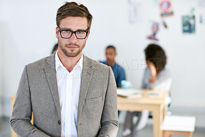 Buy stock photo Portrait of a young man standing in an office. The commercial designs displayed in this image represent a simulation of a real product and have been changed or altered enough by our team of retouching and design specialists so that they are free of any copyright infringements