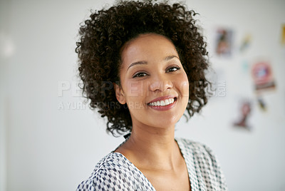 Buy stock photo Portrait of an attractive young businesswoman in the office. The commercial designs displayed in this image represent a simulation of a real product and have been changed or altered enough by our team of retouching and design specialists so that they are free of any copyright infringements