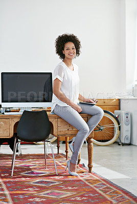Buy stock photo Portrait of an attractive female designer in her modern office. The commercial designs displayed in this image represent a simulation of a real product and have been changed or altered enough by our team of retouching and design specialists so that they are free of any copyright infringements
