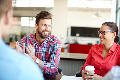 Buy stock photo Shot of a group of young designers in a meeting