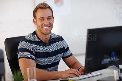 Buy stock photo Portrait of a young male designer working at his computer