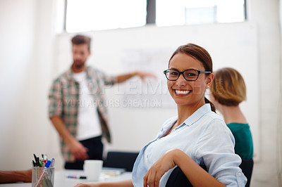 Buy stock photo Portrait of a young female designer in a meeting with her colleagues