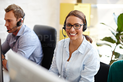 Buy stock photo Shot of customer service representatives taking calls in their office