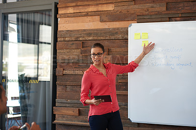 Buy stock photo Cropped shot of an attractive young woman giving a presentation