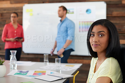 Buy stock photo Portrait of an attractive young woman sitting in a presentation by two of her colleagues