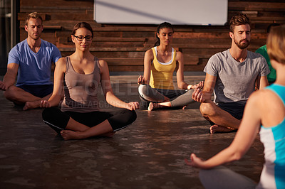 Buy stock photo Shot of a yoga instructor instructing her class