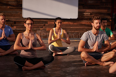 Buy stock photo A group of people doing yoga together