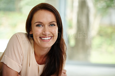 Buy stock photo Portrait of a beautiful woman relaxing at home