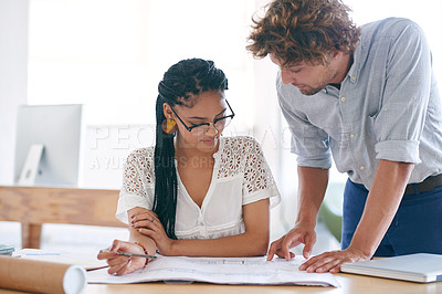 Buy stock photo Cropped shot of two young designers working together in their office