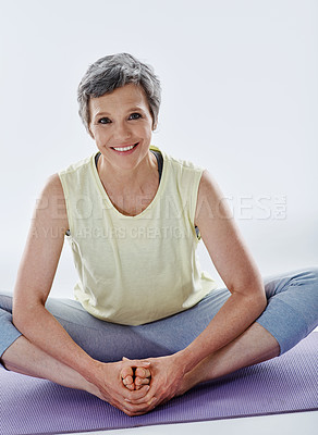 Buy stock photo Full length portrait of an attractive woman stretching before yoga