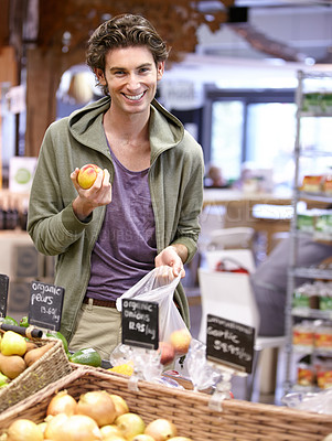Buy stock photo A young man holding an oniom
