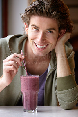 Buy stock photo A young man drinking a cold beverage