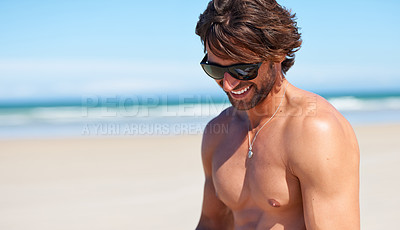 Buy stock photo An attractive young man having fun at the beach