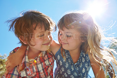 Buy stock photo Shot of an affectionate brother and sister embracing in their backyard