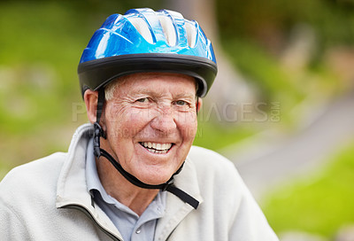 Buy stock photo Closeup portrait of a sporty mature man wearing bicycle helmet in countryside