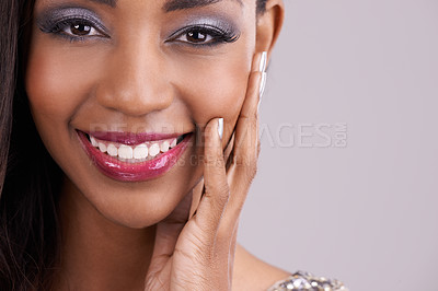 Buy stock photo Cropped shot of an attractive and elegant young woman posing against a purple background