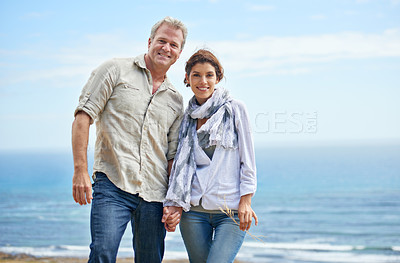Buy stock photo Shot of a mature couple posing for the camera in front of a scenic view