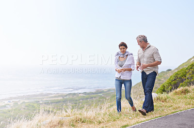 Buy stock photo A couple walking along the road