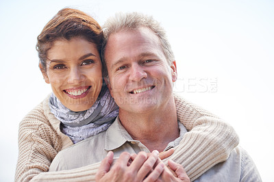 Buy stock photo Portrait of a mature couple embracing lovingly while enjoying a day out in nature