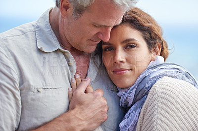 Buy stock photo Cropped portrait of mature woman resting her head on her husband's chest